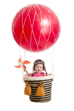 cheerful kid on hot air balloon photo