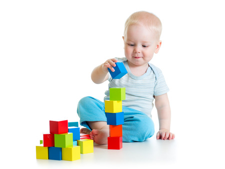 baby toddler playing with building block toys photo