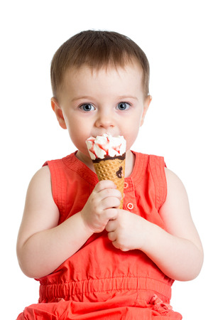 smiling kid girl eating icecream photo