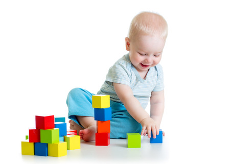 kid boy playing  wooden block toys photo