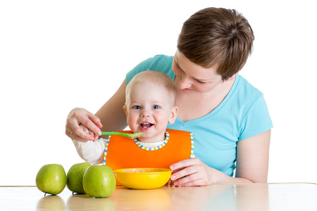 baby eating healthy food with mother photo