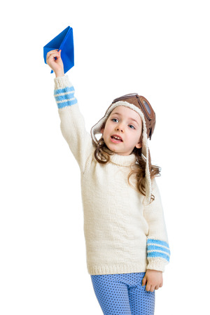 paper airplane: kid girl dressed as pilot and playing with paper airplane isolated on white background