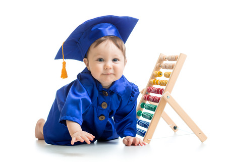 early learning: smiling baby weared academical clothes with counter Stock Photo