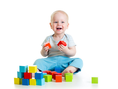 kid boy playing wooden toys photo