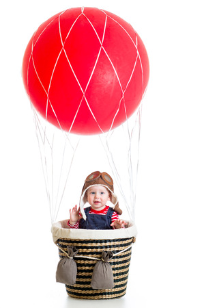 baby boy on hot air balloon photo