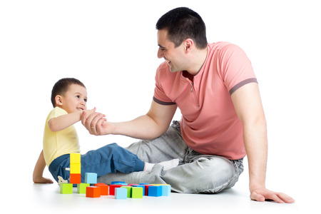 kid and his father play with building blocks photo