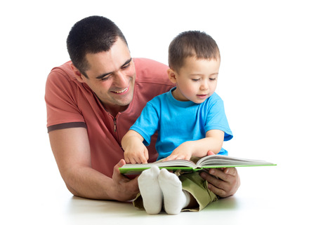 kid boy and father read a book