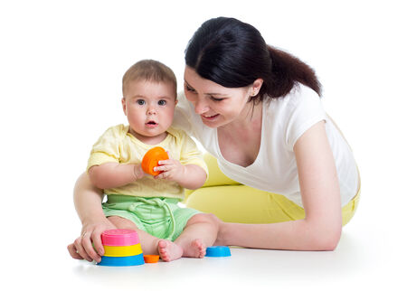 kid girl and mom playing together with colorful toys photo