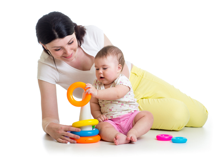 baby girl and mom playing together with toy photo