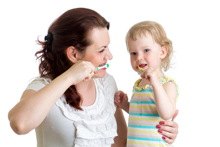 mother teaches kid teeth brushing photo