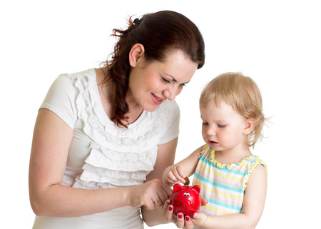 happy mother and kid put coins into daughters piggybank photo