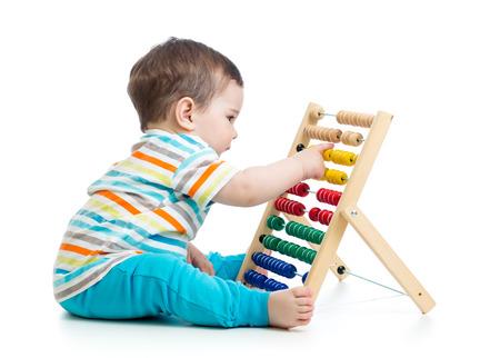 abaco: bebé que juega con el ábaco Foto de archivo