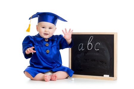Baby in academician clothes  sitting at chalkboard photo