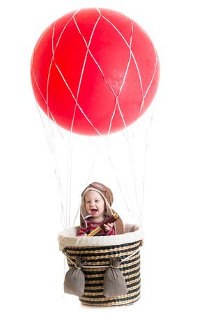 baby boy on hot air balloon photo