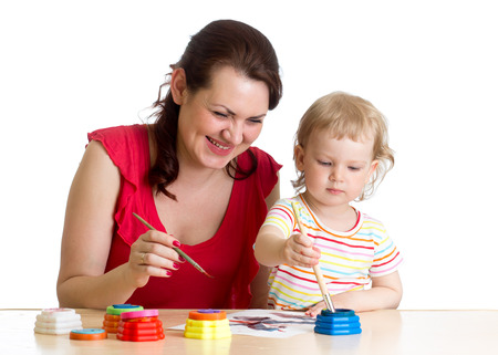 mother and child girl painting together photo