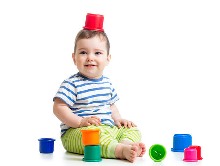 Funny little child is playing with toys photo