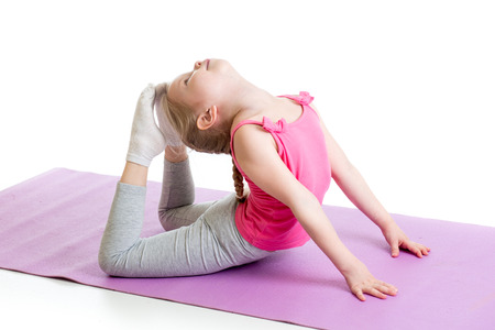 kid girl doing gymnastics Stock Photo