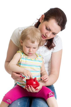 Mother and kid putting coins into piggy bank photo