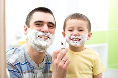 Father teaching his son boy how to shave Stock Photo