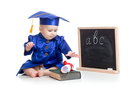 childcare: Baby in academician clothes  with book at  blackboard