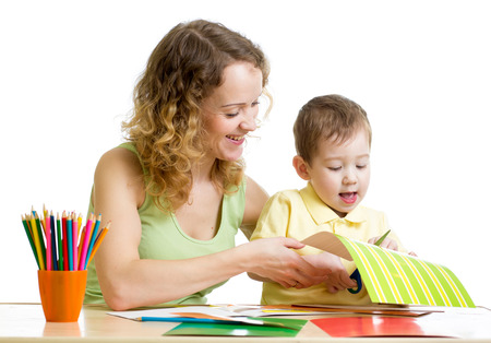 Mother and child draw and cut together photo