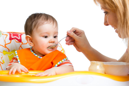 baby eating: baby eating food on kitchen