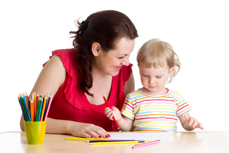 teaching crayons: mother and her child girl pencil together Stock Photo