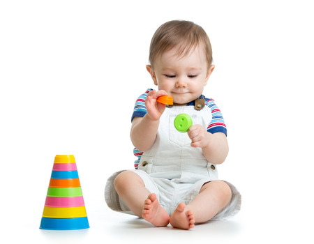 baby boy playing with toy isolated on white background photo