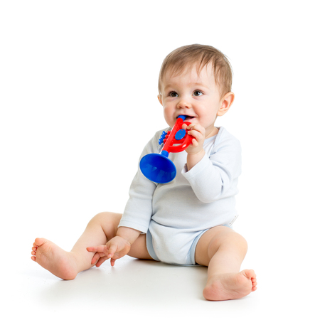 baby playing with musical toys isolated on white background Stock Photo