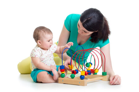 baby and mom play with color educational toy photo