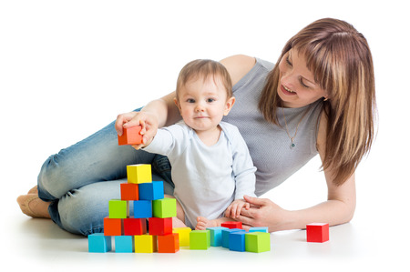 baby boy and mother playing together with  toys photo