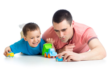 Kid boy and father play with car toys photo