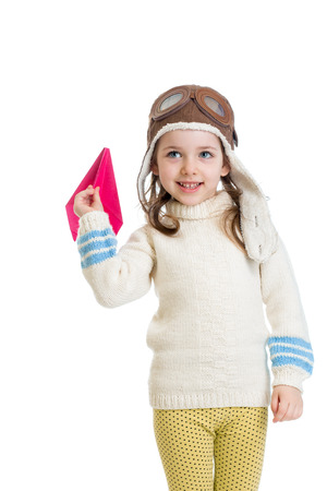 little girl dressed as pilot and playing with paper airplane isolated on white background Stock Photo - 28426327