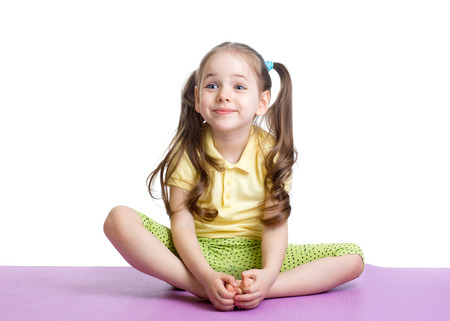 a young baby: Child girl doing fitness exercises Stock Photo