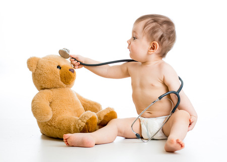kid boy playing doctor with toy photo