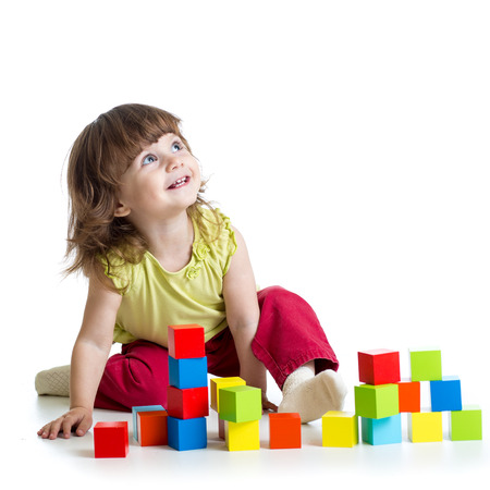 smiling kid girl playing building block toys Stockfoto