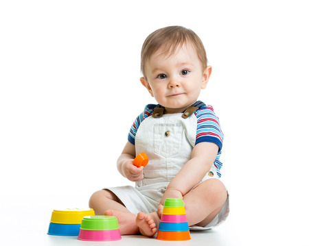 kid boy playing with toy isolated on white background photo