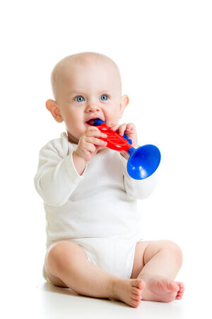 baby playing musical toy photo