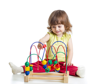 baby girl with educational toy photo