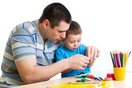 Father and child boy play clay together photo
