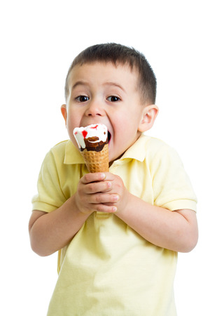 happy kid boy eating ice cream in studio isolated photo