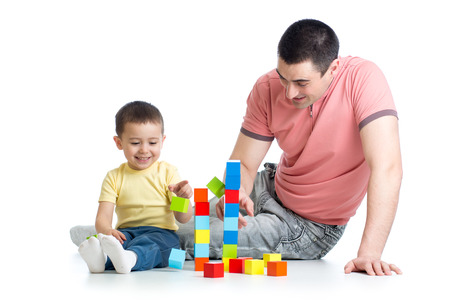 play blocks: kid and his dad play with building blocks