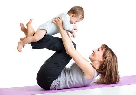mama: mother with baby do gymnastic exercises