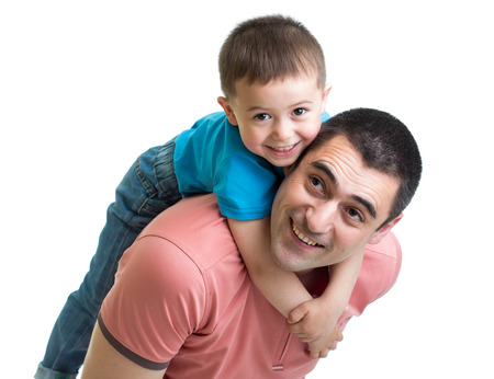 day care: happy father holding his son on his back isolated on white