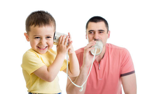 listening to people: Kid and dad having a phone call with tin cans Stock Photo
