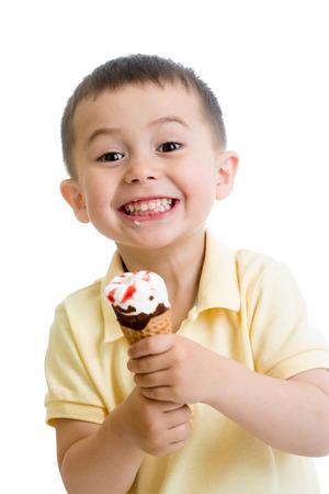 happy child boy eating ice cream in studio isolated photo