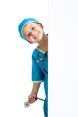 child boy uniformed as doctor behind banner photo