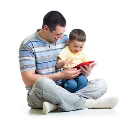 child and father looking to play and read tablet computer photo
