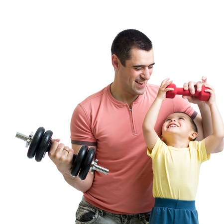 athletes: man and son doing exercise with dump-bells