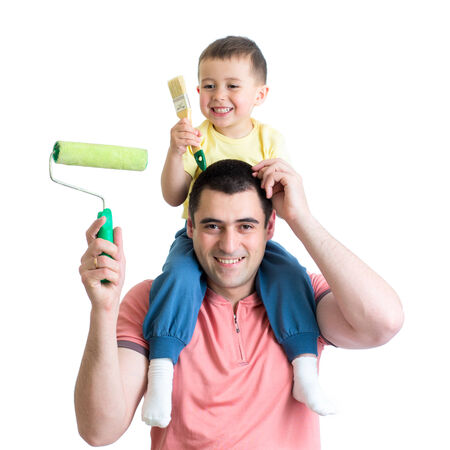 renovating: father and son ready to paint the room Stock Photo